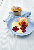 Swabian popovers with vanilla sauce and cherry compote