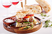 Greek burger with goat's cheese and lamb on flatbread