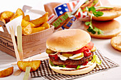 A classic hamburger with wedges, pickles, mayonnaise and ketchup