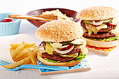 Classic double cheeseburgers with french fries and coleslaw