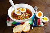Vegetarian vegetable jelly with agar agar, boiled egg and baguette slices