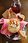 Bavarian Knöcherl: pork trotter stock in a mason jar, with bread
