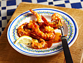 Fried shrimps in garlic and tomato sauce with lemon (Spain)