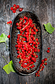 Redcurrants in a rusty bowl