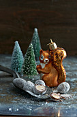 Christmas truffles, squirrel-shaped bauble and tiny Christmas trees