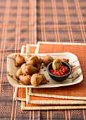 Plantain beignets with a sweet and spicy tomato sauce