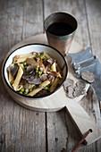 Penne al coccio (pasta with porcini mushrooms, bacon and truffles, Italy)