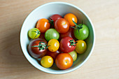 Colourful tomatoes in small bowls