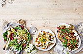 Green salad with pickled grapes, warm potato salad with cheesy sauce, festive slaw