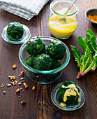 Spinach balls with hollandaise and pine nuts