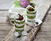 Vegan matcha tiramisu in glasses with fresh berries