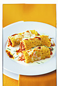 Polenta roulade gratin with minced meat filling and bechamel sauce