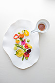An arrangement of marinated summer vegetables with tomato marinade