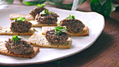 Make tapenade and sesame crackers