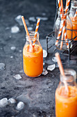 Healthy vegetable juice with carrots, ginger and orange