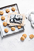 Almond biscuits next to old family photos