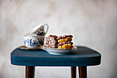 Stuffed chocolate-vanilla biscuits and teacups