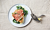 Fish saltimbocca with spinach