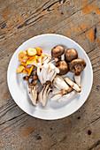 Various mushrooms on a plate