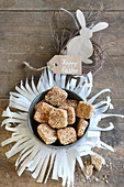 Pastries in bowl on fringed paper mat with Easter decoration