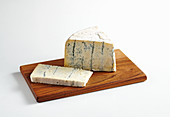 Gorgonzola with blue mold on a wooden board