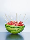 Watermelon cubes on wooden skewers