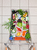 Overhead view of shopping cart with food
