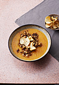 Apple bowl with carrots, sea buckthorn and nut crumbles