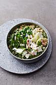 Green bulgur bowl with kohlrabi and feta cheese