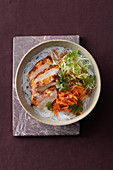 Tandoori chicken on a bed of glass noodles
