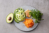 Sliced and grated vegetables and fruit for bowls