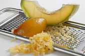 Candied orange with a grater