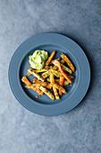 Colourful chips with an avocado dip