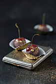 Cherries with coloured chocolate and gold glitter