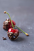 Cherries with chocolate, chocolate sprinkles and lavender flowers