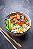 Asian style noodles with teriyaki chicken, vegetables and green peas pods