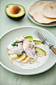 Ceviche with coconut, avocado, banana and homemade corn tortillas