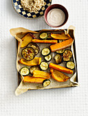 Oven-roasted vegetables with a tahini dip and quinoa