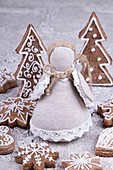 A cloth Christmas angel and different gingerbread cookies