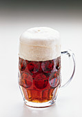 Dark strong beer in a glass jug (bock beer)