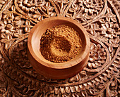 Palm sugar (India) in a small wooden bowl