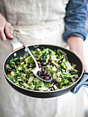 Endive and olives stewed in a pan