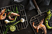 Grilled shrimp and onions with chile pepper and lime served on small grill grates