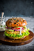 Vegan burger made with chickpeas pattie, vegetables and lemony coconut cream dressing.