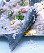 Fish in a salt crust with garlic and lemons