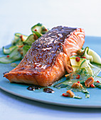 Salmon with a honey glaze on cucumber salad