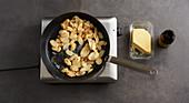 Jerusalem artichokes being fried in butter
