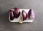 Red cabbage, quartered and destemmed