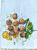 Meatball kebabs with padron peppers