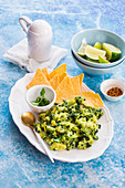 Kale guacamole with tortilla chips